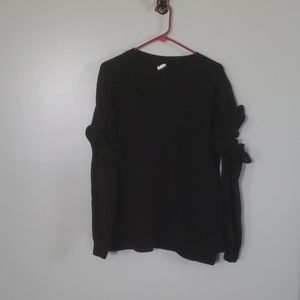 Black sweater with cold arm cut outs